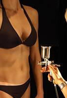 spray tanning by beautician at Unique Beauty Parlour Purley Croydon tan